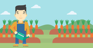 Farmer with watering can vector illustration. An asian farmer holding a watering can. Farmer watering carrots. Farmer standing on the background of carrots Stock Photography