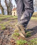 Farmer wear muddy boots in daily busines. Farmer wearing muddy boots in daily business. Muddy rubber boot in horse farm area royalty free stock photo