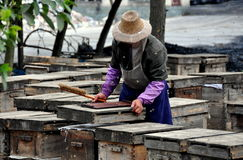 Pengzhou, China: Farmer Tending to Bee Hives Stock Images