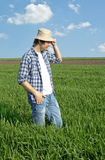 Farmer in a wheat field. Farmer in a wheat field against blue sky Royalty Free Stock Image