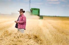 Farmer in wheat field Royalty Free Stock Photos