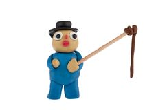 Farmer with whip made of plasticine Royalty Free Stock Photography