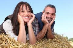 Farmer and wife laying in hay royalty free stock images