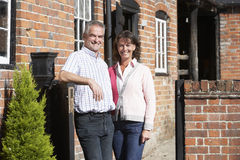 Farmer And Wife Standing In Front Of Farmhouse Stock Photography