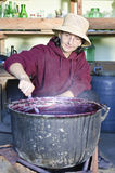 Farmer woman boiling jam Stock Photos