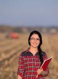 Farmer woman on field Stock Photography