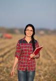 Farmer woman on field Stock Photo