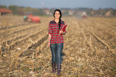 Farmer woman on field Royalty Free Stock Images