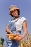 Farmer woman with maize Royalty Free Stock Images