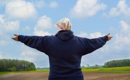 The farmer woman meditating. Royalty Free Stock Image