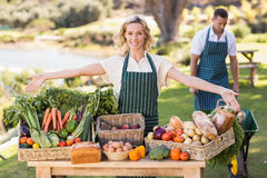Farmer woman presenting a table of local food Royalty Free Stock Image
