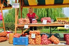 Farmer woman selling potatoes Stock Photo
