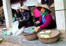 Farmer woman selling rice cakes Royalty Free Stock Photography