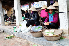 Farmer woman selling rice cakes Royalty Free Stock Image