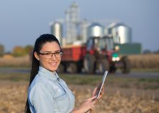 Farmer woman with tablet and silos Royalty Free Stock Photography