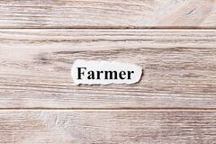 Farmer of the word on paper. concept. Words of Farmer on a wooden background.  Stock Photos