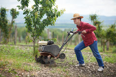 Farmer at work ploughing virgin soil Stock Image