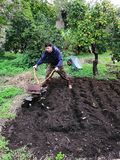 Farmer at work ploughing virgin soil. stock image