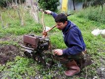 Farmer at work ploughing virgin soil. royalty free stock photos