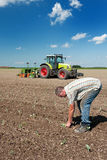 Farmer working in the fields Stock Photos