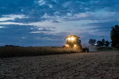 Harvester combine at dusk, Illinois royalty free stock images