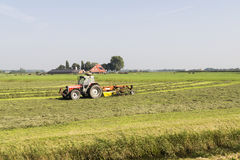 Farmer working on his land with a tractor Royalty Free Stock Images