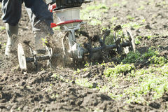 Farmer working with a plow machine Royalty Free Stock Photo