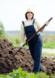 Farmer works with manure Stock Photos