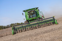 Farmers combining soybeans in fall harvest Stock Photos