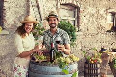 Farmers couple drinking wine in a farm royalty free stock images