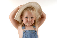 Farmers daughter II. Girl with hat Stock Images