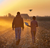 Farmers with drone on field Royalty Free Stock Photos