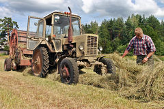 Farmers field , agronom tractor-driver at work checking fresh ha Stock Images
