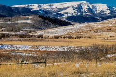 Farmers field, cowboy Trail, Alberta, Canada. Snowy field and foothills make for a great ride on the cowboy trail Royalty Free Stock Photos