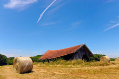 Farmers field with hay bales Stock Photography