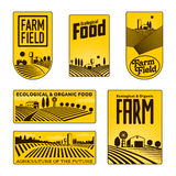 Farmers with fields badges Stock Images