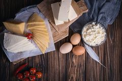 Farmers food products: milk, cream, cheese, eggs, cottage, butter. Rustic composition. Organic food concept. Farmers food products: milk, cream, cheese, eggs Royalty Free Stock Image