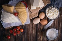 On Farmers food products: milk, cream, cheese, eggs, cottage, butter. Rustic composition. Organic food concept. Farmers food products: milk, cream, cheese, eggs Royalty Free Stock Image