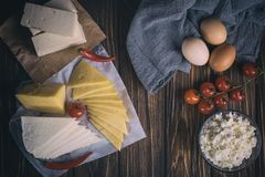Farmers food products: milk, cream, cheese, eggs, cottage, butter. Rustic composition. Organic food concept. Farmers food products: milk, cream, cheese, eggs Royalty Free Stock Images