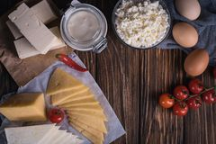 Farmers food products: milk, cream, cheese, eggs, cottage, butter. Rustic composition. Organic food concept. Farmers food products: milk, cream, cheese, eggs Stock Photography