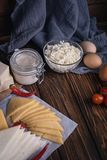 Farmers food products: milk, cream, cheese, eggs, cottage, butter. Rustic composition. Organic food concept. Farmers food products: milk, cream, cheese, eggs Royalty Free Stock Photography