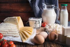 Farmers food products: milk, cream, cheese, eggs, cottage, butter. Rustic composition. Organic food concept. Farmers food products: milk, cream, cheese, eggs Stock Images