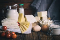 Farmers food products: milk, cream, cheese, eggs, cottage, butter. Rustic composition. Organic food concept. Farmers food products: milk, cream, cheese, eggs Royalty Free Stock Photo