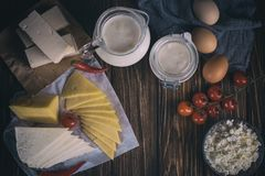 Farmers food products: milk, cream, cheese, eggs, cottage, butter. Rustic composition. Organic food concept. Farmers food products: milk, cream, cheese, eggs Stock Image