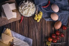 Farmers food products: milk, cream, cheese, eggs, cottage, butter. Rustic composition. Organic food concept. Farmers food products: milk, cream, cheese, eggs Stock Photos