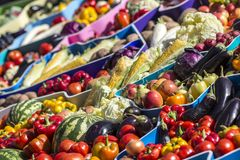 Farmers fruit market with various colorful fresh fruits and vegetables stock photography