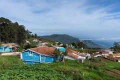 Farmers hamlet in Thalaikunha valley, Nilgiri Hills, India. Nilgiri Hills, India - October 26, 2013: Thalaikunha hamlet with small farms and green and brown Royalty Free Stock Image