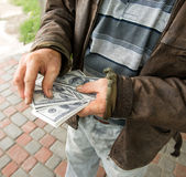 Farmers hands holding pack of money Royalty Free Stock Image