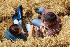 Farmers on hay Royalty Free Stock Photos