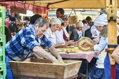 Farmers making talos in fair of Santo Tomas. San Sebastian. San Sebastian, Basque country, Spain - December 21, 2017: Basque farmers Baserritarras making Talos royalty free stock photos